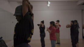 "Showcasing up-and-coming Hiphop dancing stars in Toronto, ""All It Gives"" follows the story of Kosi Eze, a Nigerian immigrant."