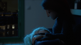 A mother doll holding her child.