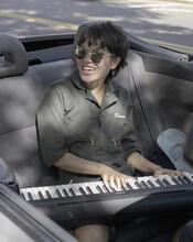 Sharon playing keyboard in car
